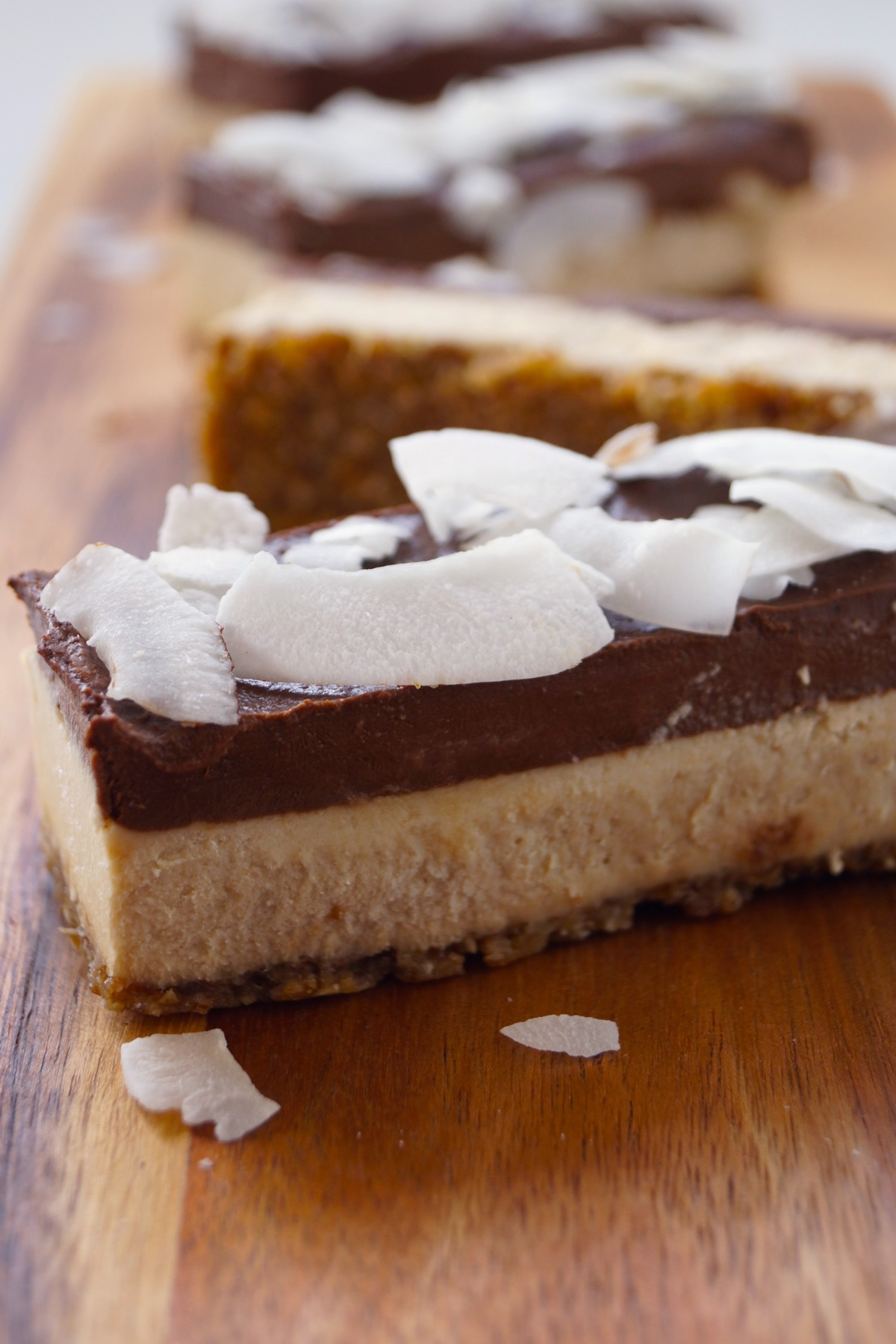Decadent 3-layer Chocolate-Coconut-Cheesecake Bars