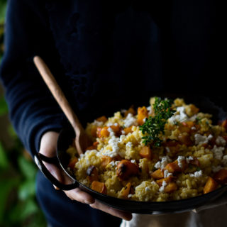A baking tin full of roasted pumpkin & millet risotto