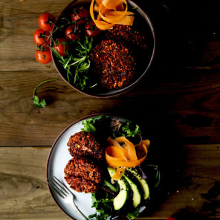 Two bowls of salad with Beetroot Buckwheat Patties