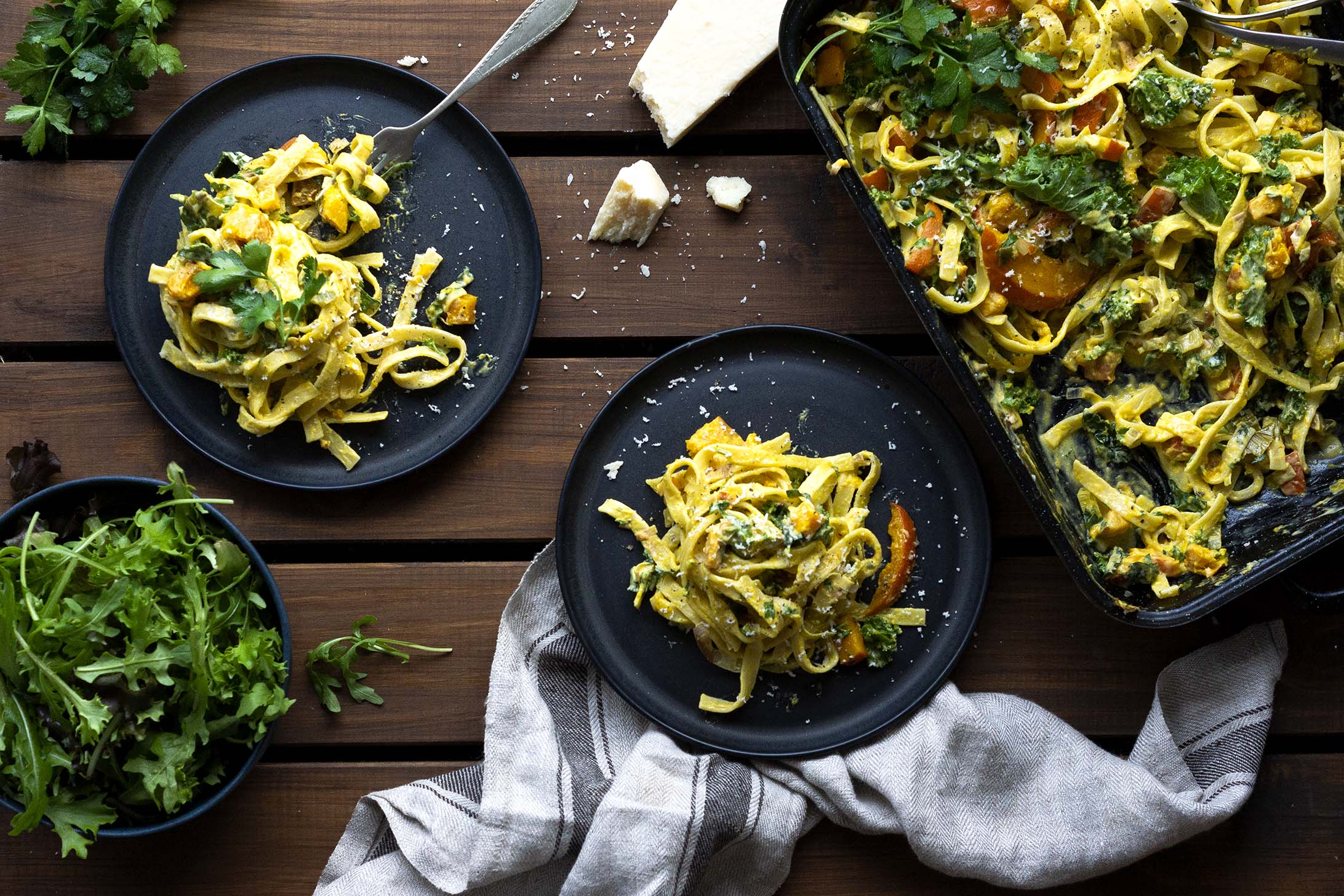 Roasted Hokkaido & Kale Fettuccine on two plates & in a baking dish