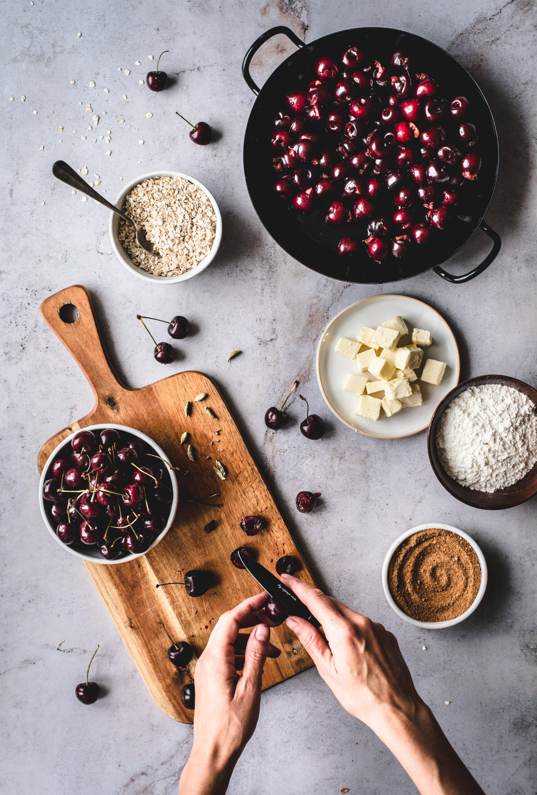 Pitting Cherries for a Cherry Cardamom Crumble