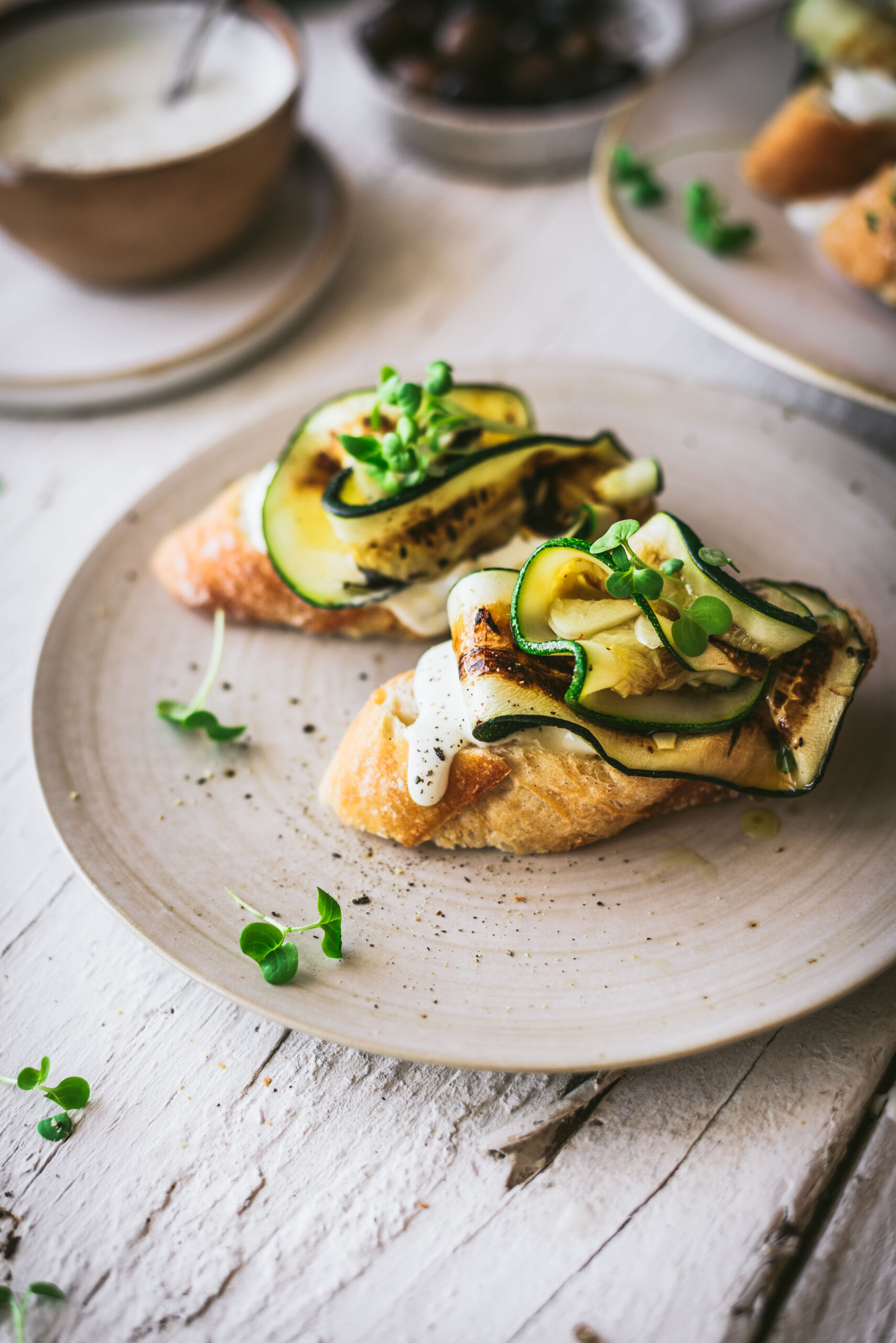 A crispy crostini topped with grilled, garlicky zucchini