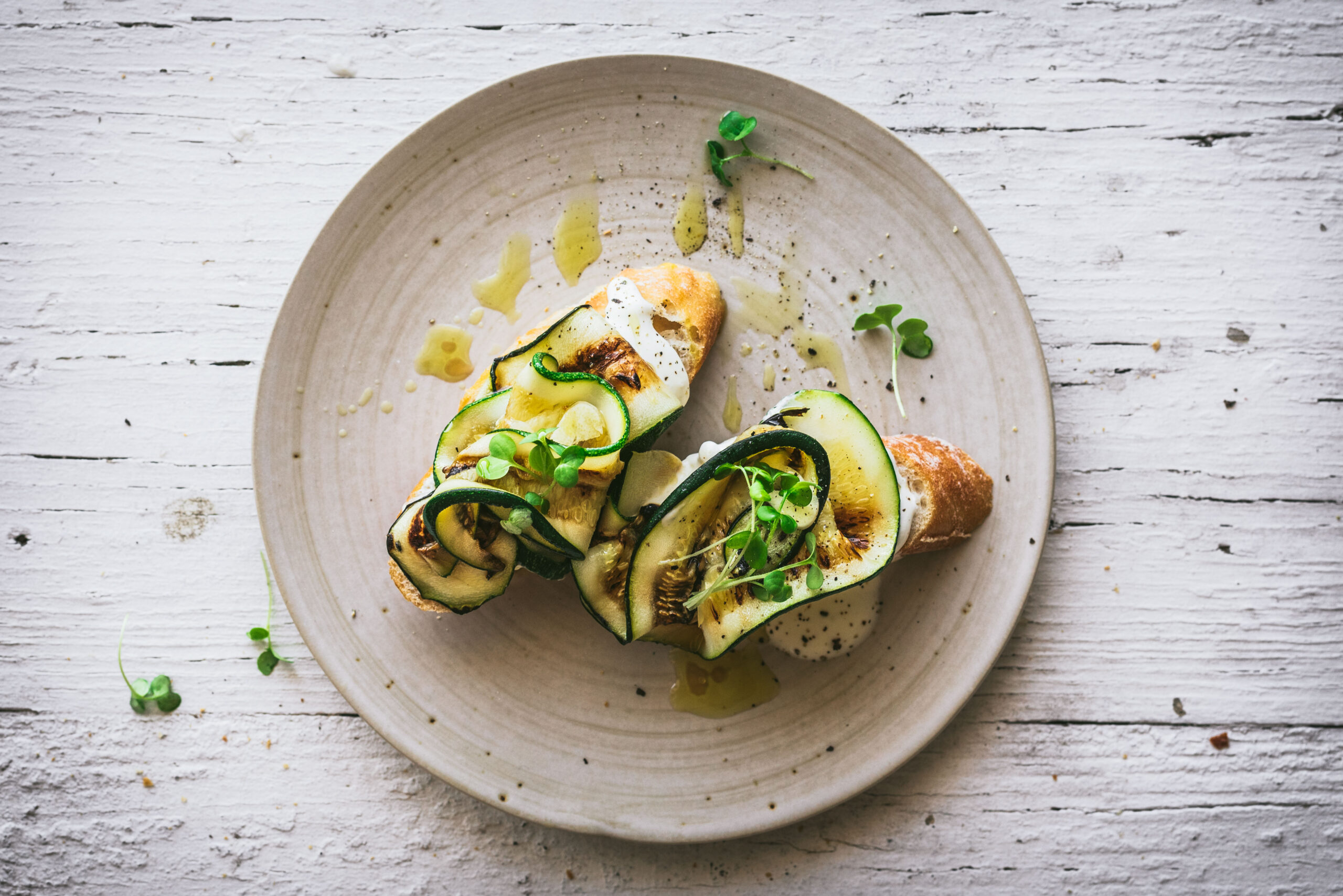 A crispy crostini topped with whipped feta & grilled zucchini